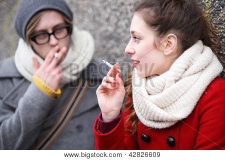 Young couple with cigarettes