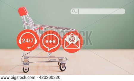 Contact Icon On Red Round Paper Cut With Search Bar And Shopping Cart In Soft Focus On Wood And Gree