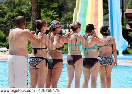 Marmaris, Turkey - July 2021: People Doing Aqua Aerobics In Aquapark Near The Swimming Pool. Water S