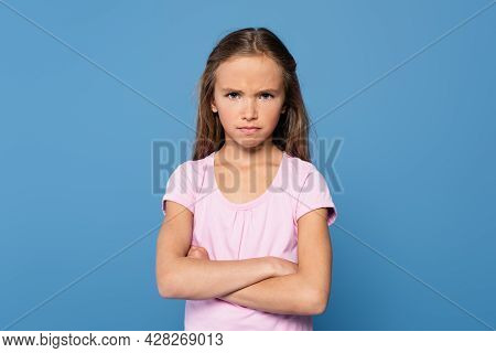 Offended Girl With Crossed Arms Looking At Camera Isolated On Blue