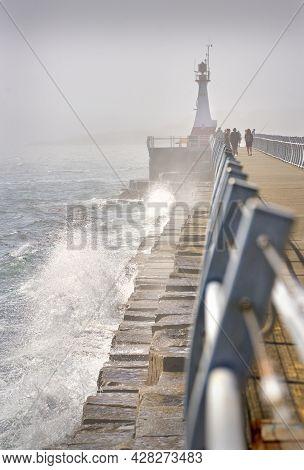 Ogden Point Lighthouse Fog. A Foggy Day As Waves Crash Against The Ogden Point Breakwater And Lighth