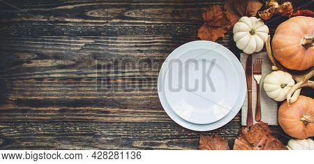 Banner Of Holiday Place Setting With Plate, Napkin, And Silverware On A Thanksgiving Day Decorated T
