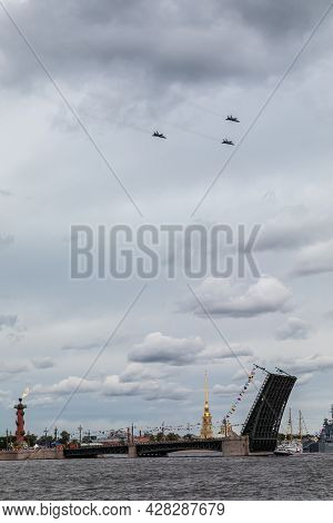 July 22, 2021, St. Petersburg, Russia. Military Fighter Planes Fly Over The Neva. The Bridges Are Di