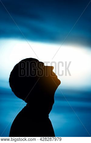 Toned Photo Of Man Head Silhouette On The Sky Background