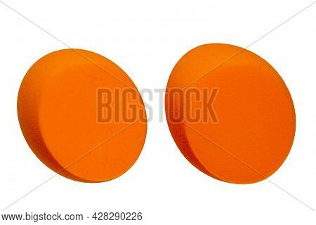 Sponge Isolated. Close-up Of Two Orange Cosmetic Sponge Isolated On A White Background. Beauty Conce