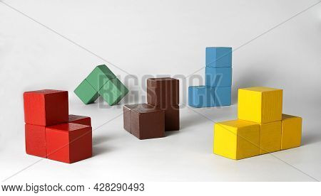 Multi-colored Cubes Of Various Geometric Shapes For The Development Of Spatial And Logical Thinking