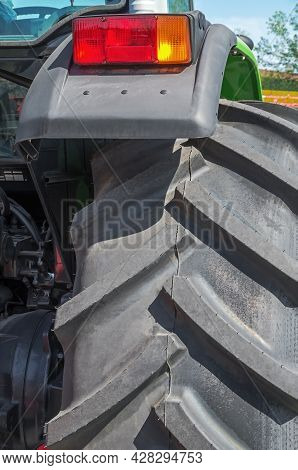 Fragment Rear Wheel And Tractor Brake Light. Tractor Fender With Brake Light, Rough Tire Profile, Si