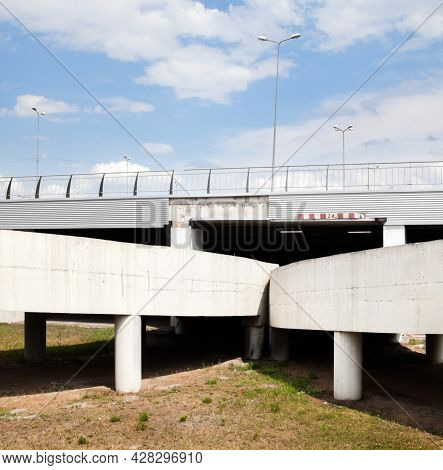 The Ramp Of The Grade-separated Road Junction. Road Under The Bridge.