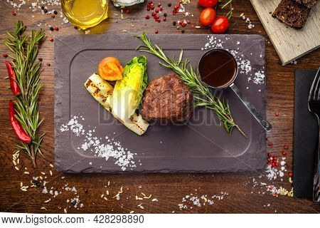 Black Angus Chateaubriant steak. Tenderloin from Brazil. Delicious healthy traditional food closeup served for lunch in modern gourmet cuisine restaurant.