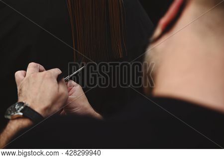Close-up Of Haircutting. Hairdressing. Master Of Hairstyles Cutting Woman's Hair In Beauty Salon