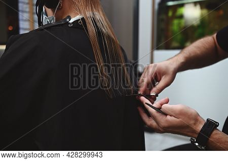 Close-up Haircut By A Professional Hair Stylist. Hairdresser Cutting Hair Of Female Client In Beauty