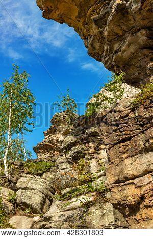 Stone City, Perm Region, Russia. Natural Landscape Landmark Reserve Park On Blue Sky Background. Dow