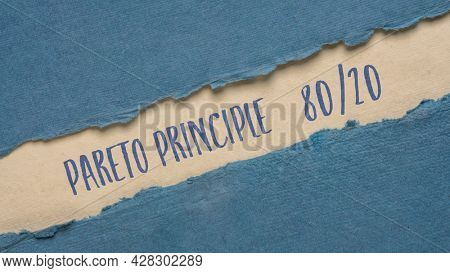 Pareto 80-20 principle banner - handwriting on a handmade rag paper, business, productivity and priorities concept