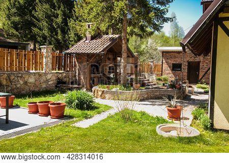 Bjelasnica, Bosnia and Herzegovicna-May 11, 2021: Garden grill in beautiful bosnian mountains, Bjelasnica. Bosnia and Herzegovina.
