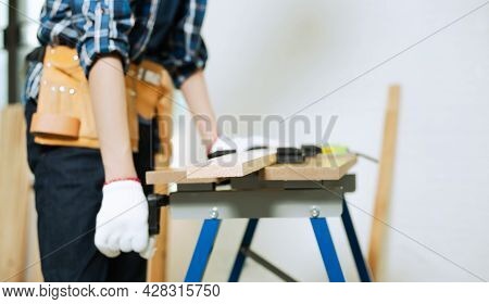 Young Carpenter Working On Woodworking In Carpentry Workshop, Carpenter Work The Wood On Workbench