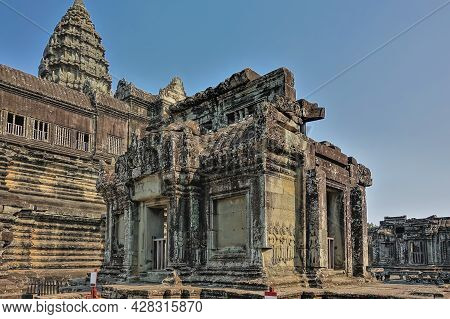 The Ruins Of An Ancient Temple In The Famous Angkor. Ornaments And Bas-reliefs Are Visible On The We