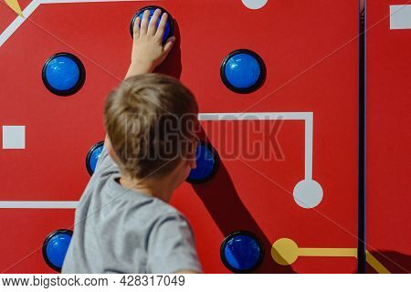 Dnepr, Ukraine- September 06, 2020: Young Boy Pushing Button On Game Machine In Entertainment Center