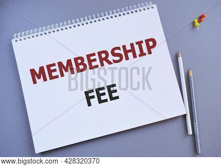 Membership Fee Message Written In Notebook, Business Concept Image With Gray Background