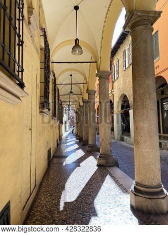 Bologna - Italy - July 3, 2021: Famous Arcade Of Bologna. Unesco Heritage Since 2021. Italy