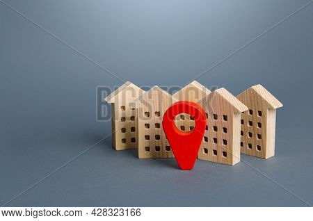 Wooden Houses And A Red Location Pin. Location, Accessibility And Proximity To Infrastructure. Resid