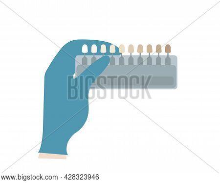 Professional Dental Shade Guide In Gloved Hand Of Dentist. Veneers, Teeth Whitening, Orthodontist. C