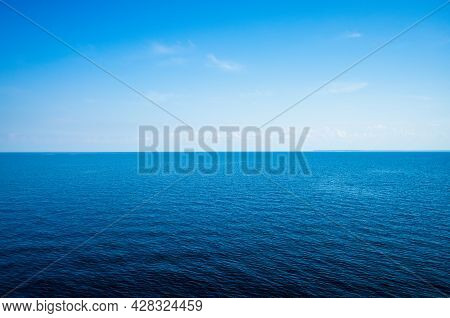 Tranquil Minimalist Landscape With A Smooth Blue Sea Surface With Calm Waters With A Horizon And Cle