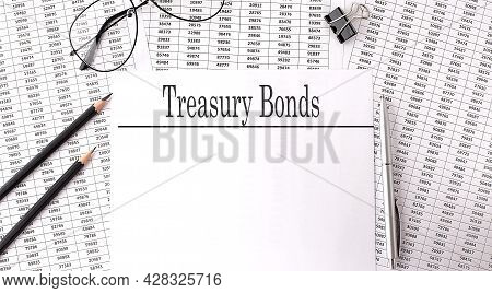 Paper With Treasury Bonds On A Table On Chart
