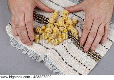 Nodi Marini, Insalatonde Pasta. A Portion Of Pasta On A White Ethnic Towel With Pattern And Fringe.