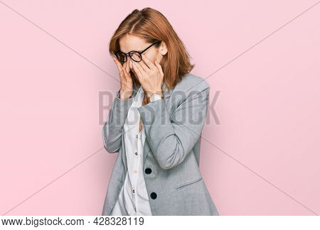 Young caucasian woman wearing business style and glasses rubbing eyes for fatigue and headache, sleepy and tired expression. vision problem