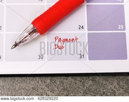 Close Up Text Payment Due Written On Calendar With A Pen. Reminder Concept Of Payment. Selective Foc