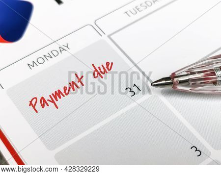 Reminder Concept Of Payment. Close Up Text Payment Due Written On Calendar With A Pen. Selective Foc