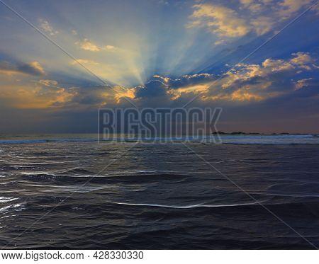 Majestic sunset scene over sea water surface