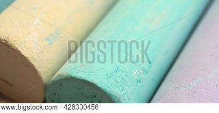 Close-up Texture Of Chalk For Drawing Multicolored Green, Blue, Yellow, Purpleclose-up Texture Of Ch