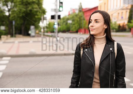 Young Woman Crossing Street. Traffic Rules And Regulations