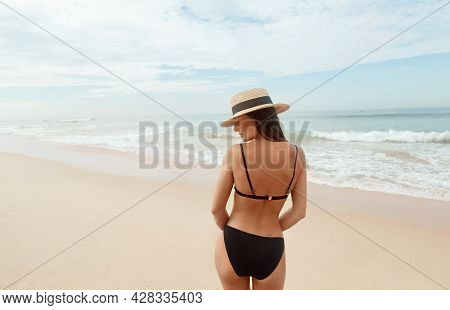 Portrait Beautiful Young Woman In Bikini On The Beach. Rear View Of Girl. Freedom Concept, Holiday,