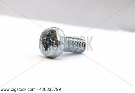 Metal Bolt To Rounded Head. Screw On White Background. Macro Closeup Metal Wares.