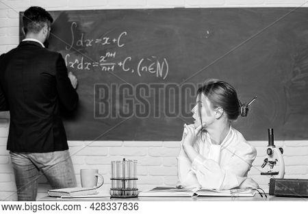 Teacher And Student Near Chalkboard. College University Education. High School. Solving Task. Man Wr