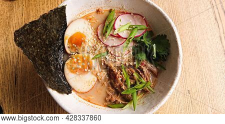 Traditional Noodle Soup, In A White Plate, On Table. Japanese Soup Called Ramen With Beef. Soup With