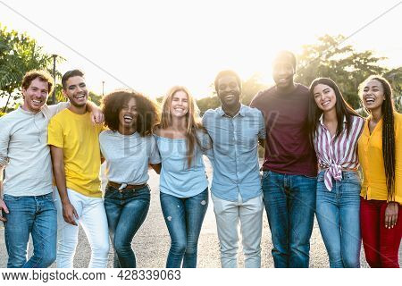 Happy Multiracial Group Of Friends Having Fun In The City Center - Young People Lifestyle Concept