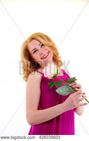 Happy Beautiful Woman With Long Blond Curly Hair And In Elegant Dress Posing With Rose Flower In Stu