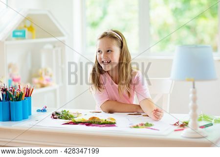 Child Creating Picture With Colorful Leaves. Art And Crafts For Kids. Little Girl Making Collage Ima