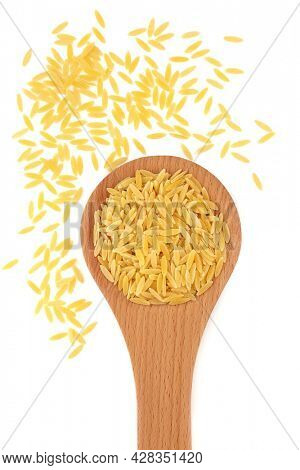 Healthy Italian vegan orzo pasta in a wooden spoon on white background. Gluten free and high in fibre, vitamins and minerals. Flat lay, top view, copy space.
