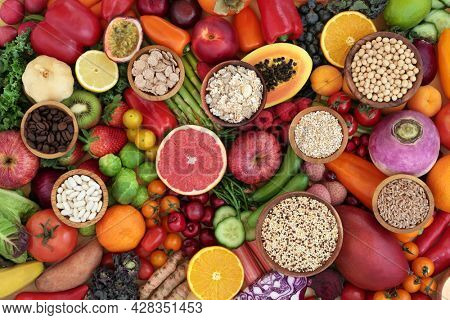 Antioxidant health food  to lower cholesterol and blood pressure with fruit, vegetables, cereals, legumes, grains, high in fibre, anthocyanins, lycopenes, carotenoids, vitamins, minerals. Flat lay.