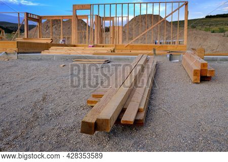 Home construction site building a structure with wood frame