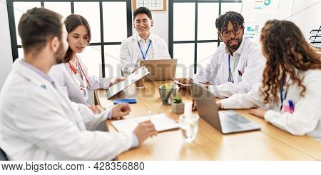 Group of young doctor people discussing in a medical meeting at the clinic office.