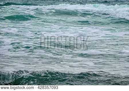 Background From The Water Of The Undulating Sea With Splash.
