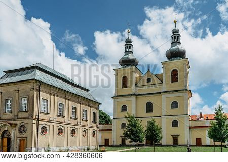 Kraliky, Czech Republic - July 12,2021. Mountain Of Holy Mother With Green Courtyard And Baroque Hed
