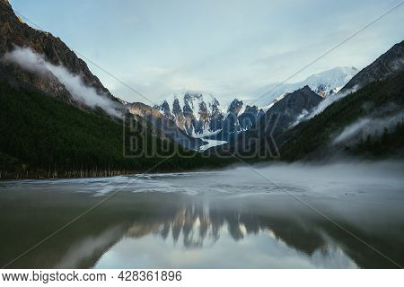 Atmospheric Alpine Landscape With Snowy Mountains In Golden Sunlight Reflected On Mirror Mountain La