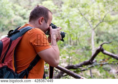 Professional Male Photographer In Forest. Guys Tourist In Nature Photography Forest Natural Environm