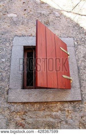 Architectural Detail: Small Rustic Window On A Traditional Mediterranean House. Vertical Format, Nat